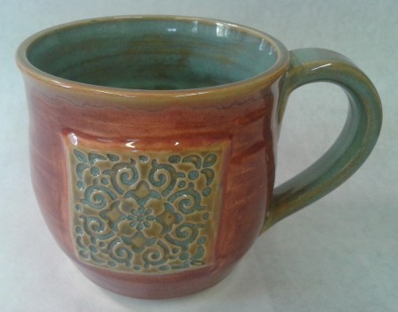 white stoneware clay Tile on side Texture Turquoise on sprig, handle and inside Plum on outside