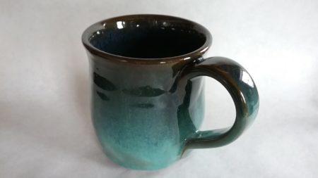 Black stoneware mug, copper and blue glazes